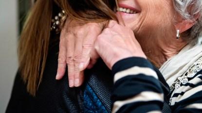 Grandma hugging grandaughter