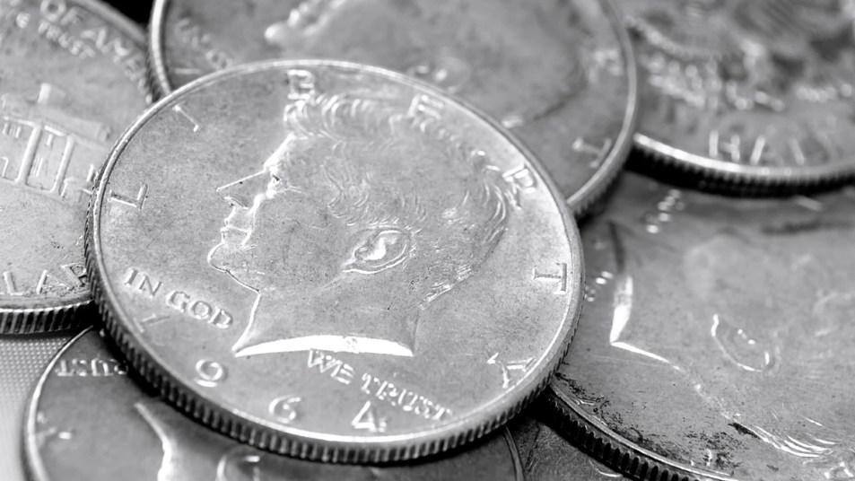 Pile of JFK half dollars
