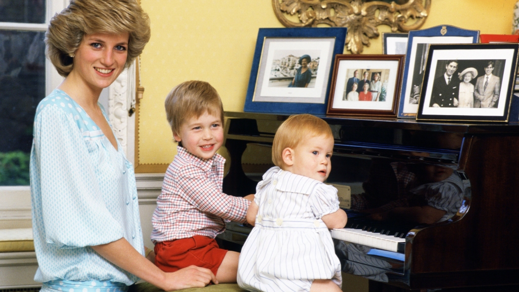 Princess Diana with young William and Harry at piano