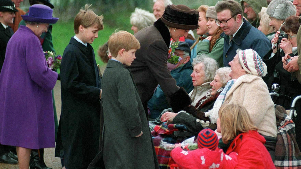 Princess Diana with young William and Harry greeting fans