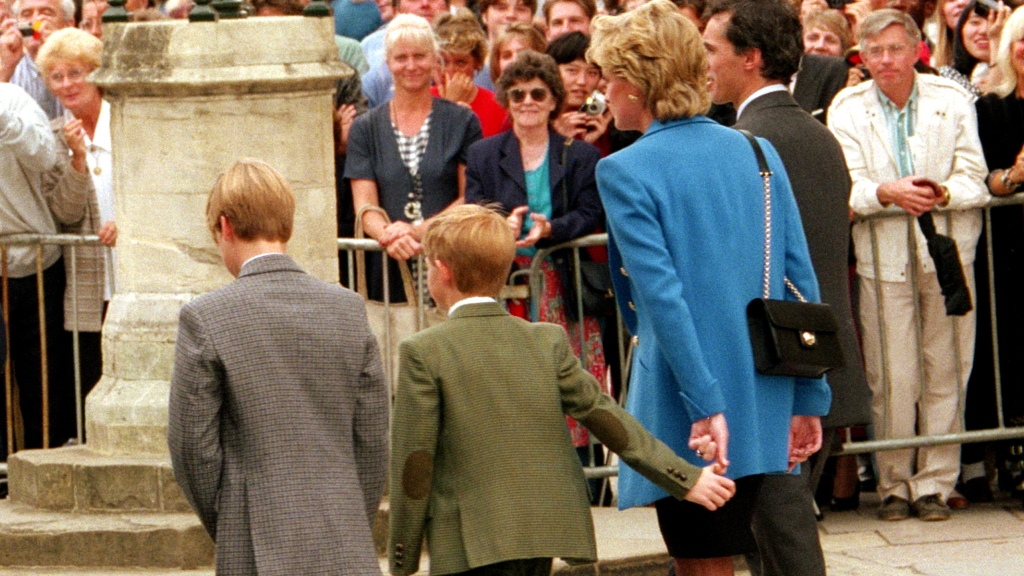 Princess Diana holding young Harry's hand