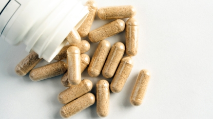 Beige supplement capsules