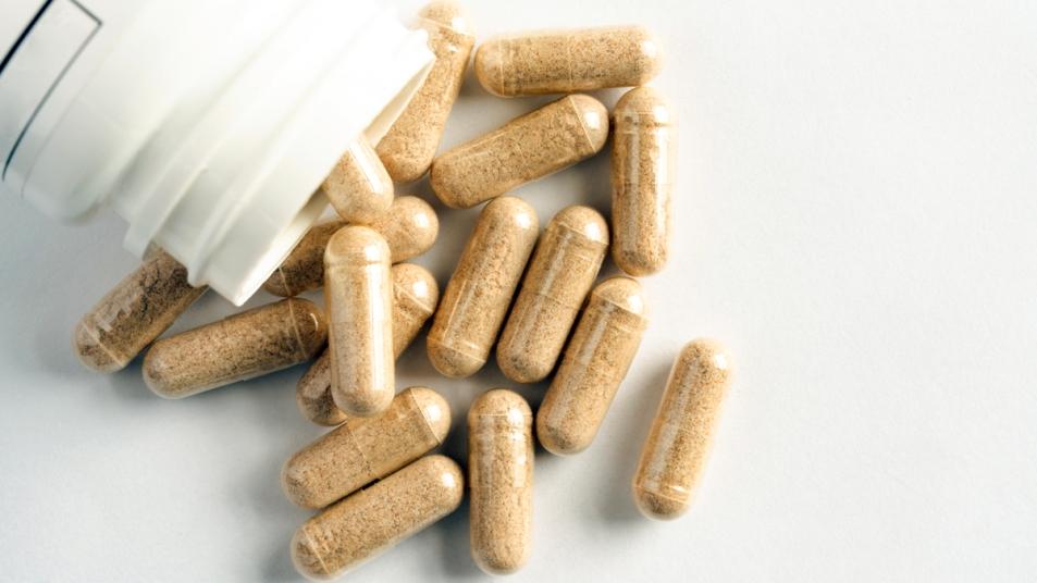 Beige supplement capsules