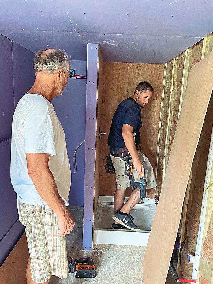 Contractors workin on Dorothy Mullins' bathroom