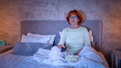 Woman eating in bed