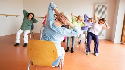 Group of women doing chair yoga