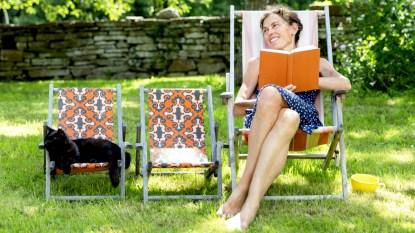 Woman lounging in her backyard