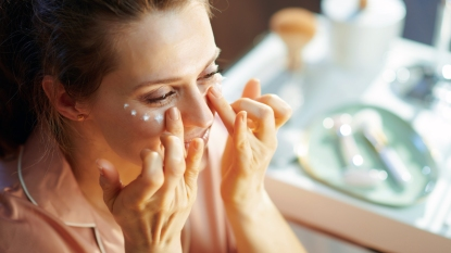 Woman applying eye cream