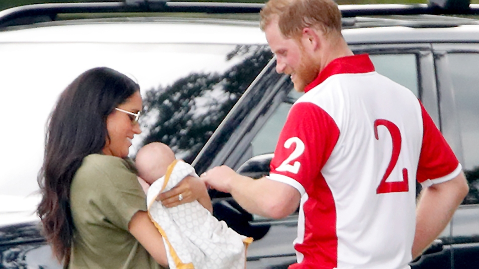 Prince Harry and Meghan holding Archie