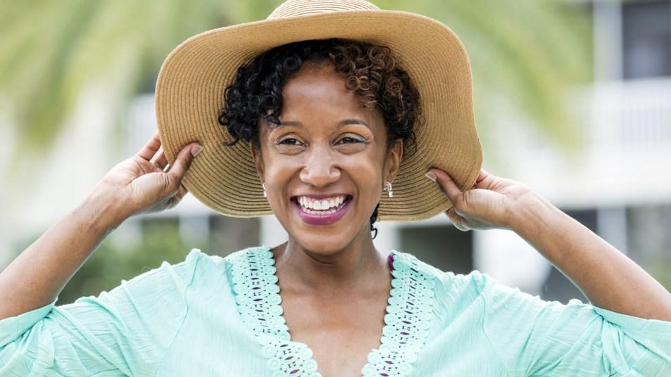 Woman outside in sun hat