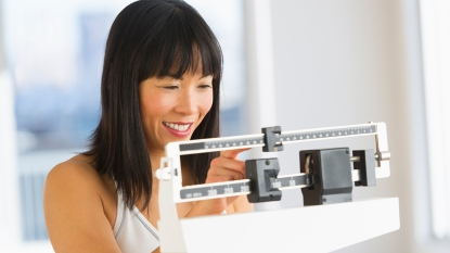 Woman adjusting a scale