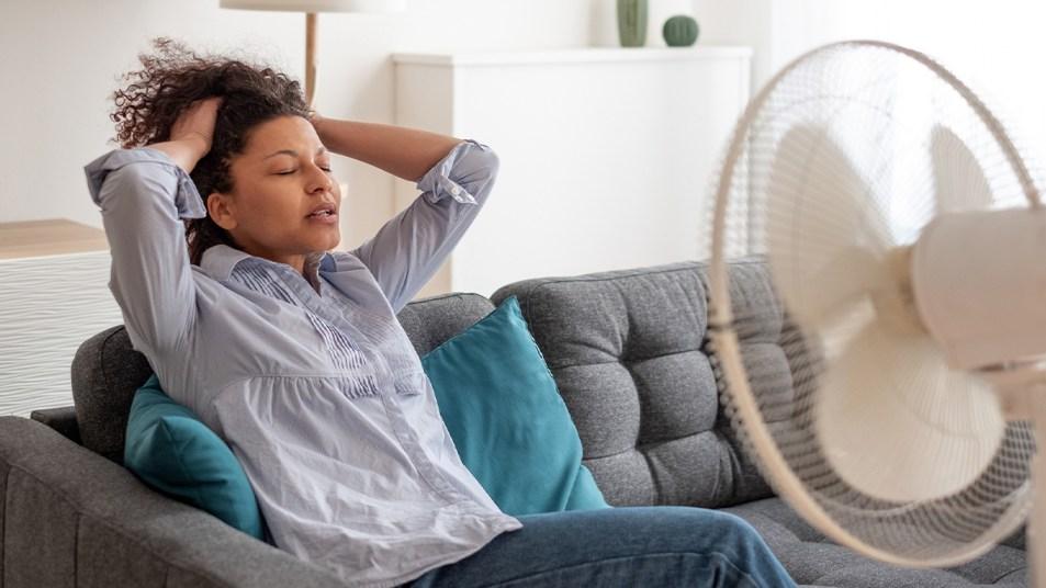 Woman sitting by a fan