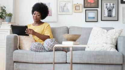 Woman sitting on her sofa