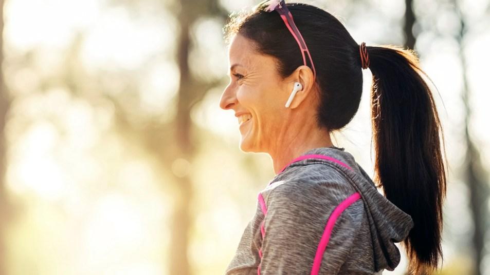 Woman outside wearing headphones