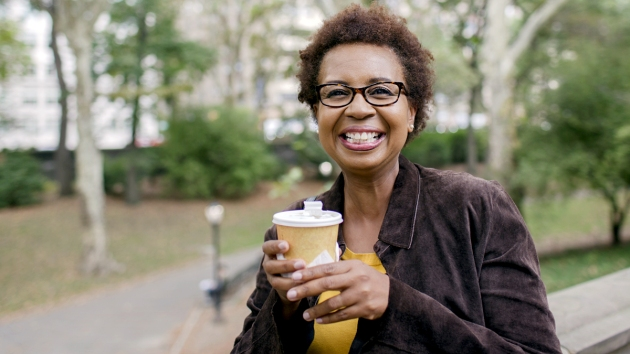 Woman holding a to-go cup of coffee