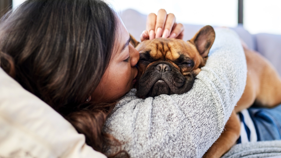 Woman snuggling puppy