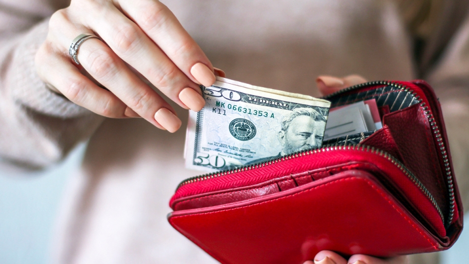 Womans hands taking money out of wallet