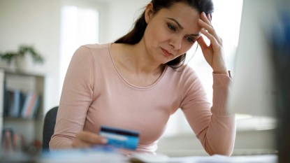 woman worrying about money