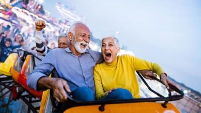 couple having fun on rollercoaster