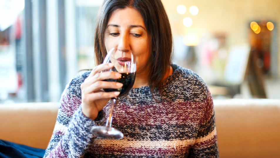 Woman sipping wine