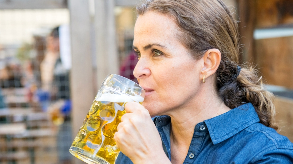 Woman sipping beer