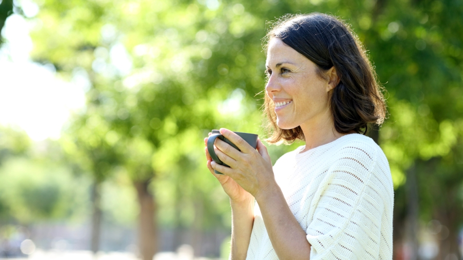 Woman sipping from a mug