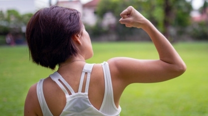 Woman flexing her arm