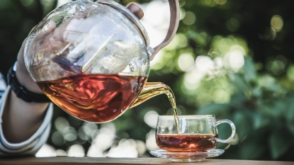 Woman pouring black tea