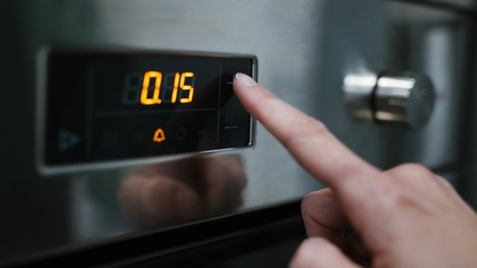 Woman preheating oven