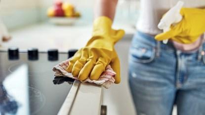Gloved hand scrubbing oven
