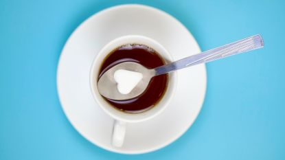 cup of coffee with a spoon full of salt