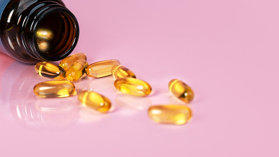 fish oil supplements spilling out of bottle