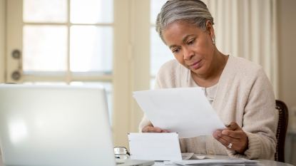 Woman Looking At Her Bills