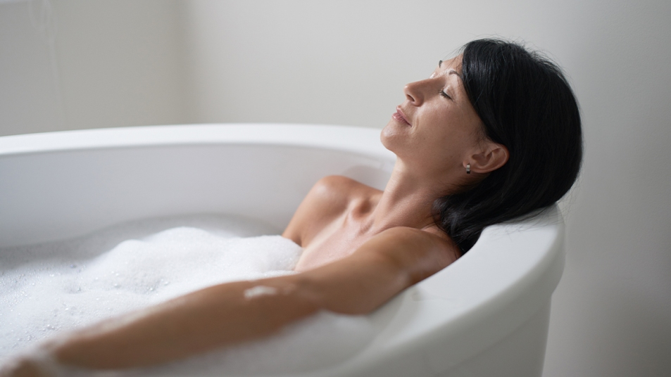 Woman relaxing and taking a bathWoman relaxing and taking a bath