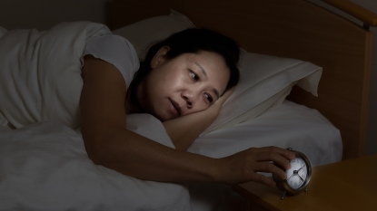 woman waking up in the middle of the night