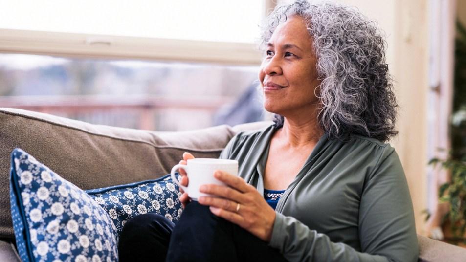 Woman relaxing with mug of tea