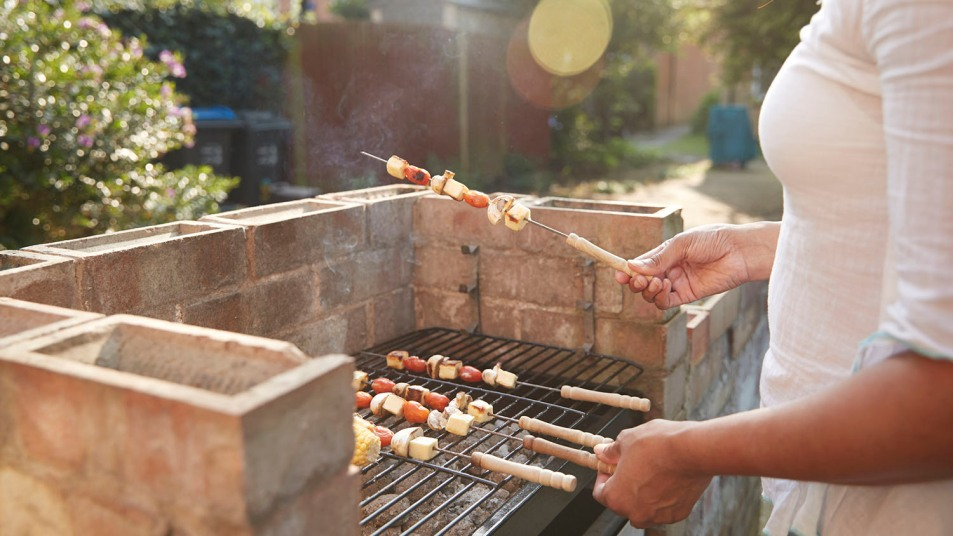 woman grilling outside in the summer