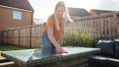 Woman cleaning an outdoor table