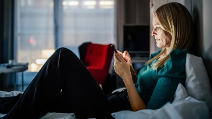 woman staring at her smartphone