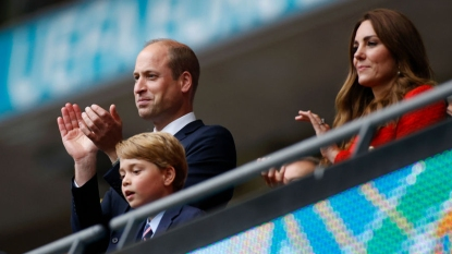 The royal family watching a soccer game
