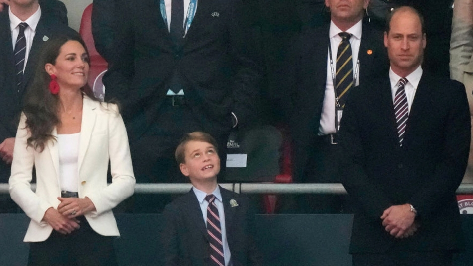 William, Kate, and George at a soccer match