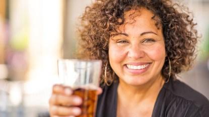 Woman drinking iced tea