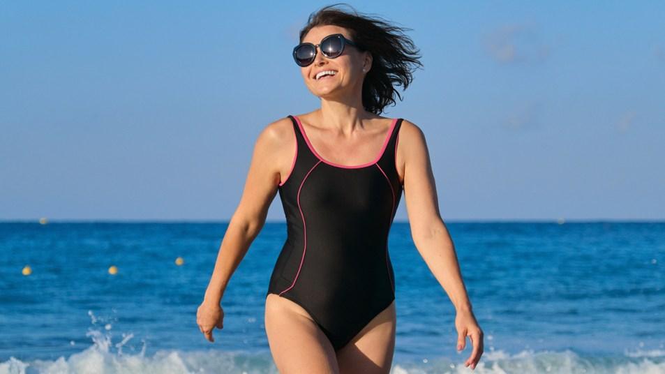 Woman enjoying herself on the beach