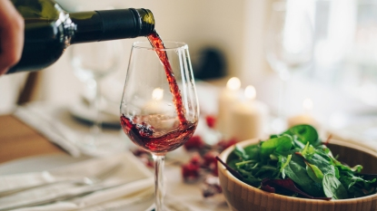 A glass of wine being poured