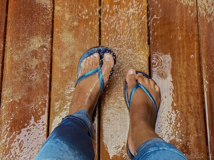 woman's feet in sandals