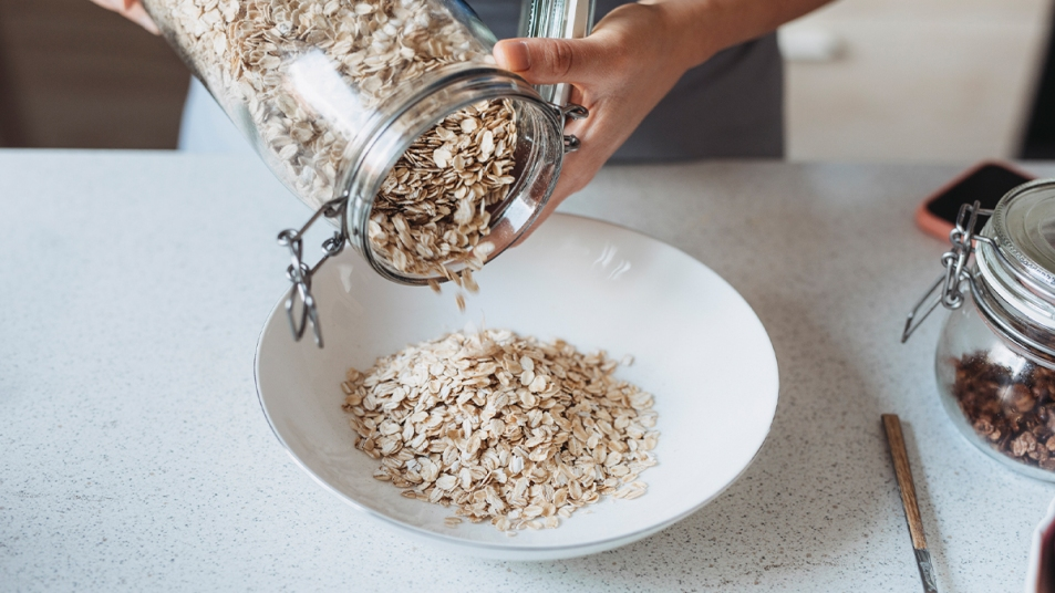 Oats being poured in a bowl
