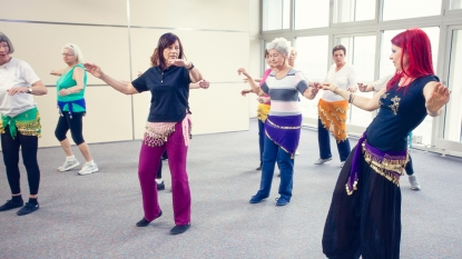 Woman taking belly dancing classes