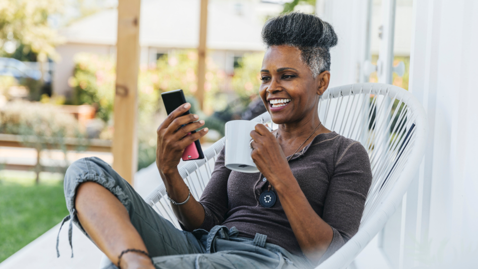 woman relaxing on her porch with a phone