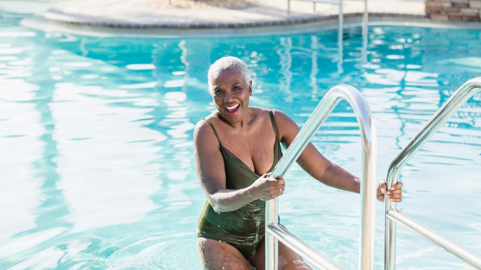 woman getting out of swimming pool