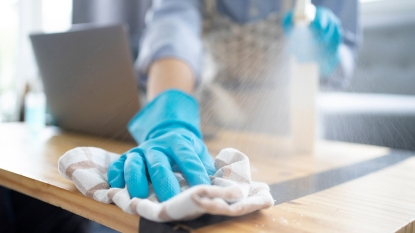 Woman wiping coffee table